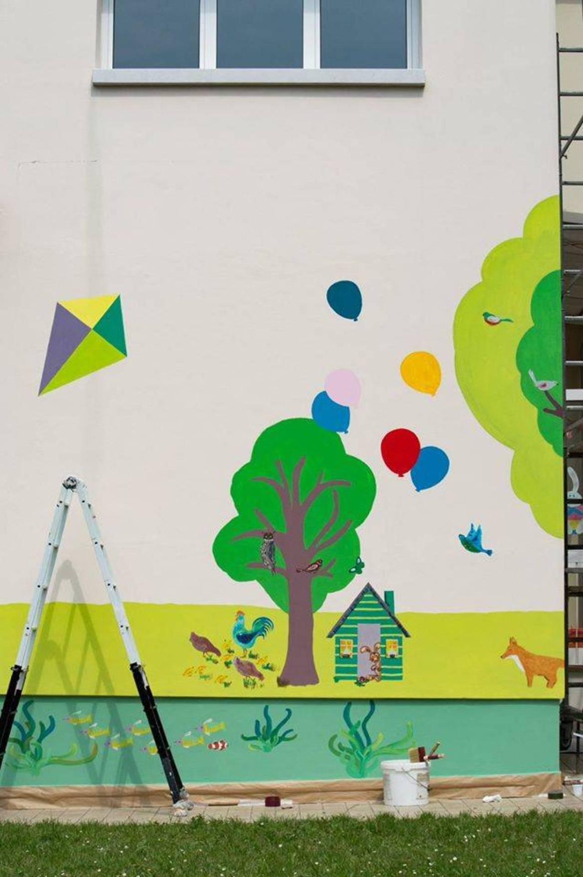 Solighetto decorati i muri esterni della materna foto - Muri esterni decorati ...